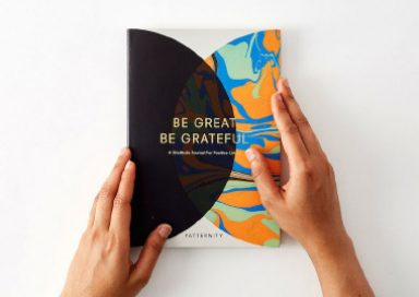 A person holding the book 'Be Great, Be Grateful' by PATTERNITY