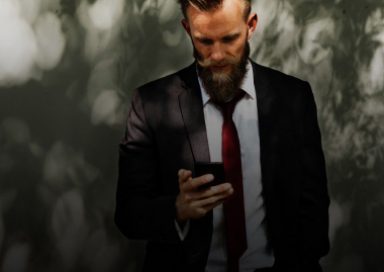 A man uses his phone to access our self help tools or therapy sessions