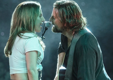Lady Gaga and Bradley Cooper singing into a microphone from the movie 'A Star is Born'